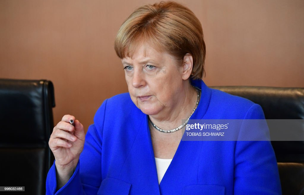 German Chancellor Angela Merkel awaits the start of the weekly cabinet meeting in Berlin on July 11, 2018.