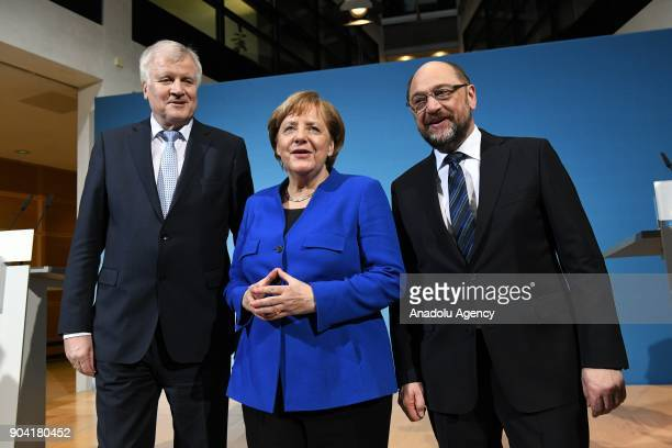 German Chancellor Angela Merkel Bavarian Prime Minister Horst Seehofer and Social Democratic Party SPD chairman Martin Schulz pose for a photo after...