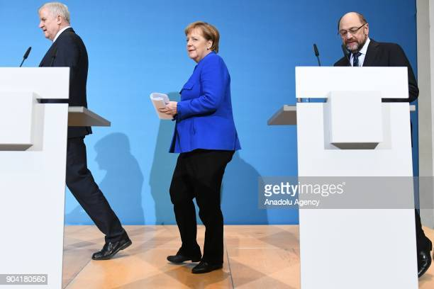 German Chancellor Angela Merkel Bavarian Prime Minister Horst Seehofer and Social Democratic Party SPD chairman Martin Schulz arrive to hold a joint...