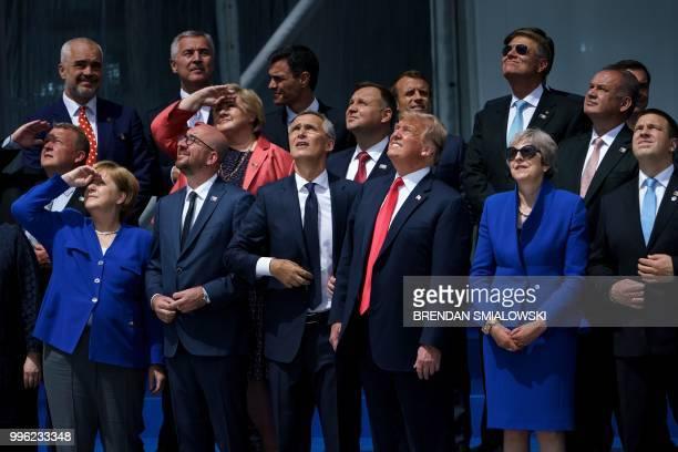 TOPSHOT German Chancellor Angela Merkel Belgium's Prime Minister Charles Michel NATO Secretary General Jens Stoltenberg US President Donald Trump...