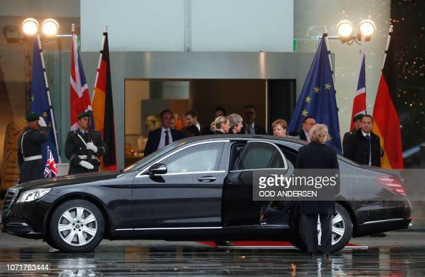 German Chancellor Angela Merkel bids farewell to British Prime Minister Theresa May before she leaves in her car at the Chancellery in Berlin on...