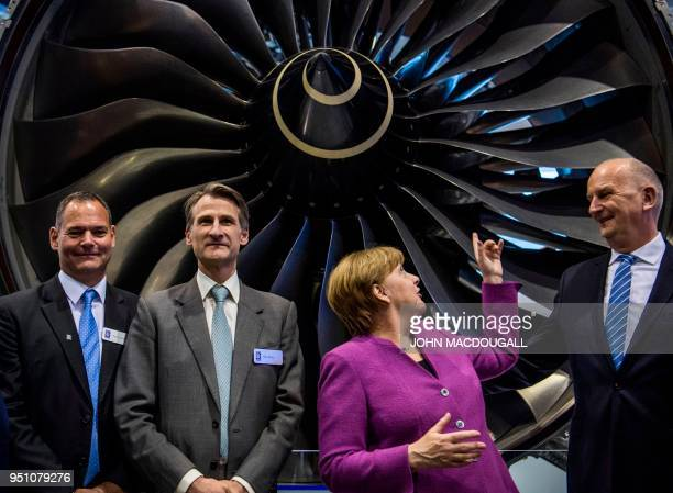 German Chancellor Angela Merkel Brandenburg's State Premier Dietmar Woidke Rolls Royce Marketing Director Ben Story and Rolls Royce Deutschland...