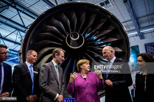 German Chancellor Angela Merkel Brandenburg's State Premier Dietmar Woidke Rolls Royce Marketing Director Ben Story Rolls Royce Deutschland Director...