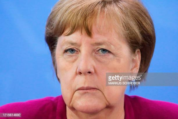 German Chancellor Angela Merkel briefs the media after a meeting with governors of eastern German states at the Chancellery in Berlin Germany...