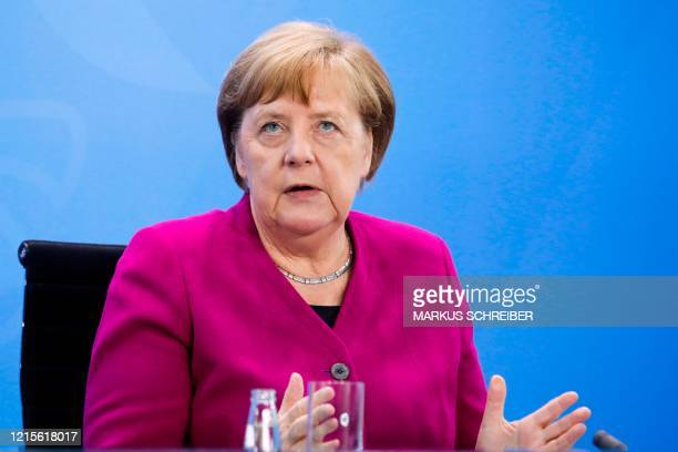 German Chancellor Angela Merkel briefs the media after a meeting with governors of eastern German states at the Chancellery in Berlin Germany on May...