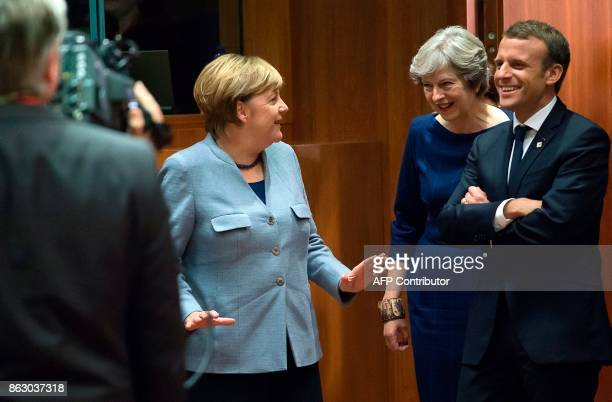 TOPSHOT German Chancellor Angela Merkel Britain Prime minister Theresa May and French President Emmanuel Macron talk as they arrive in Brussels on...