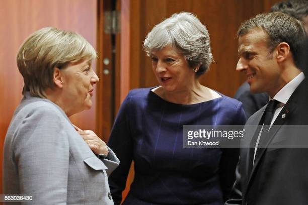 German Chancellor Angela Merkel Britain's Prime Minister Theresa May and French President Emmanuel Macron arrive for a round table meeting on October...