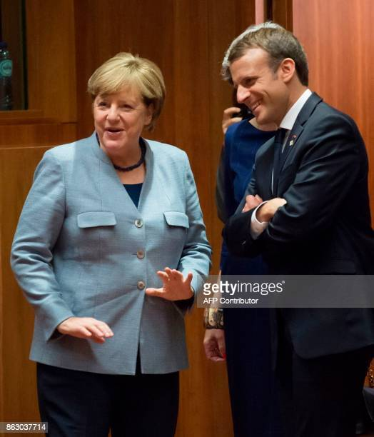 German Chancellor Angela Merkel Britain's Prime minister Theresa May and French President Emmanuel Macron talk as they arrive in Brussels on October...