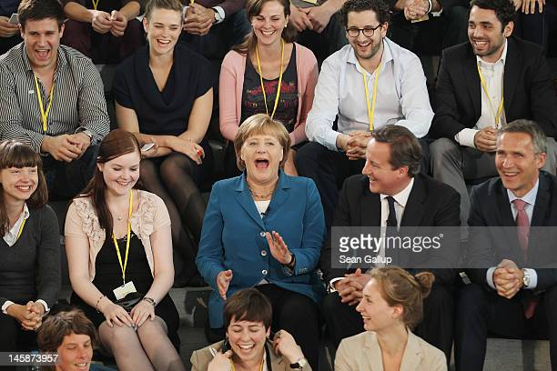 German Chancellor Angela Merkel British Prime Minister David Cameron and Norwegian Prime Minister Jens Stoltenberg meet with students at the...