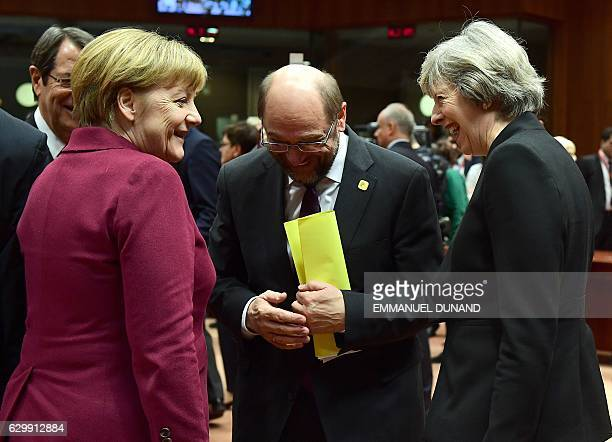 German Chancellor Angela Merkel British Prime Minister Theresa May and European Parliament President Martin Schulz share a laugh ahead of European...