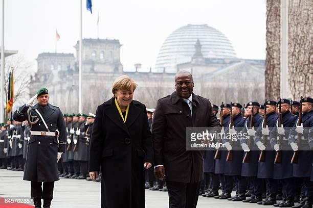German Chancellor Angela Merkel CDU welcomes Ghana's President John Dramani Mahama with military honors on January 19 2015 in the Federal Chancellery...