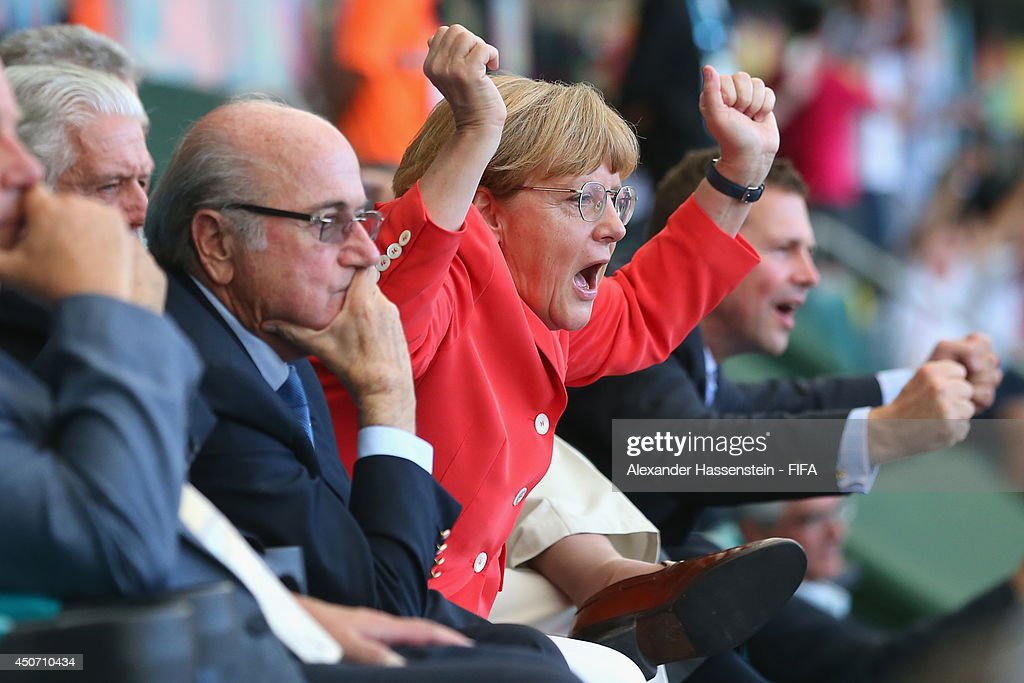 German Chancellor Angela Merkel celebrates Germany's 4th goal during the 2014 FIFA World Cup Brazil Group G match between Germany and Portugal at Arena Fonte Nova on June 16, 2014 in Salvador, Brazil.