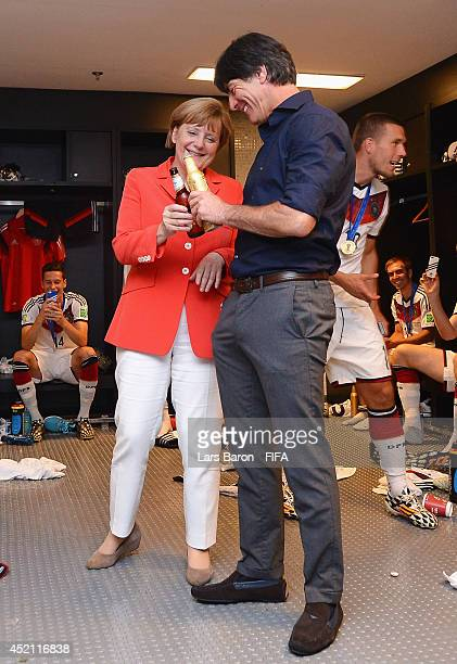German Chancellor Angela Merkel celebrates with Head Coach Joachim Loew of Germany after the 2014 FIFA World Cup Brazil Final match between Germany...