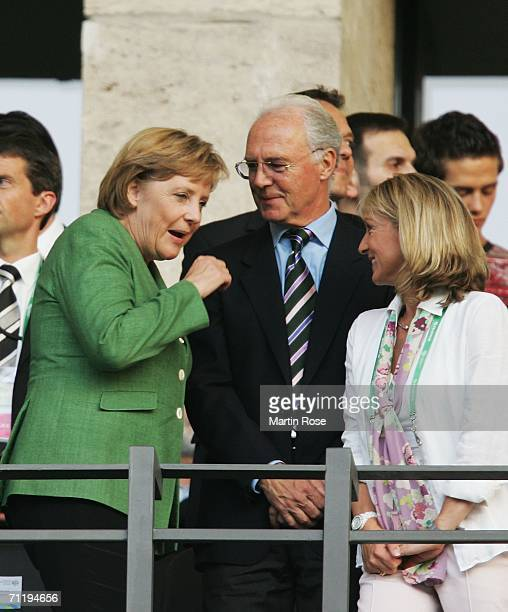 German Chancellor Angela Merkel chats to Franz Beckenbauer and his wife Heidrun Burmester prior to the FIFA World Cup Germany 2006 Group F match...