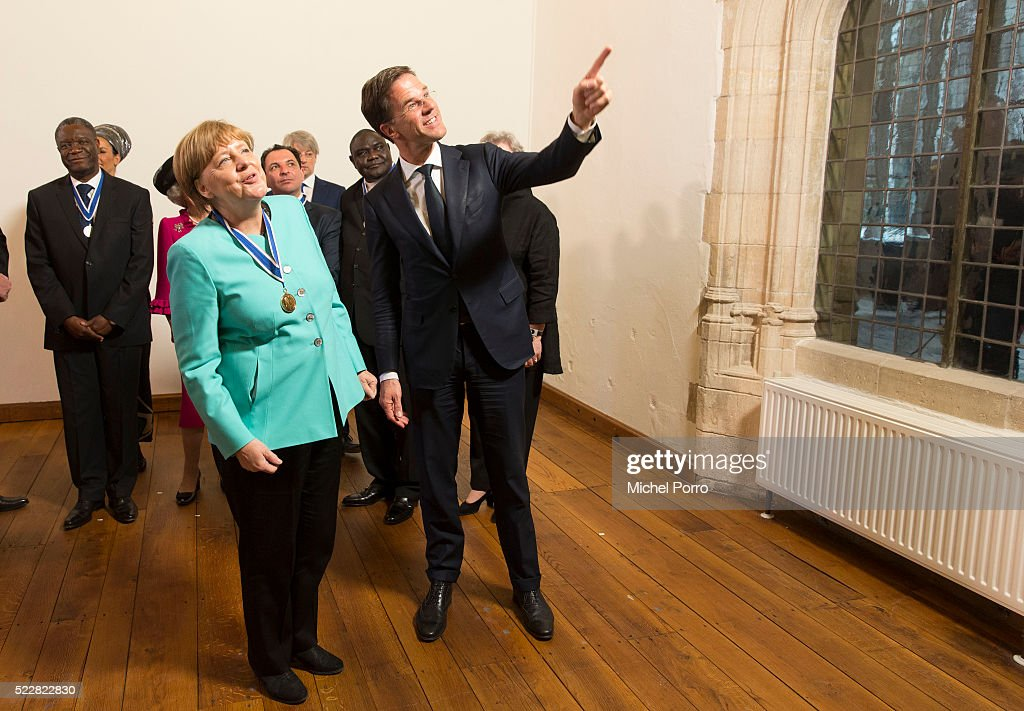 German Chancellor Angela Merkel chats with Dutch Prime Minister Mark Rutte after receiving the Four Freedoms Award on April 21, 2016 in Middelburg, Netherlands.