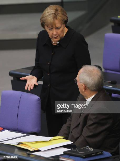 German Chancellor Angela Merkel chats with Finance Minister Wolfgang Schaeuble during debates over the federal budget at the Bundestag on September 7...