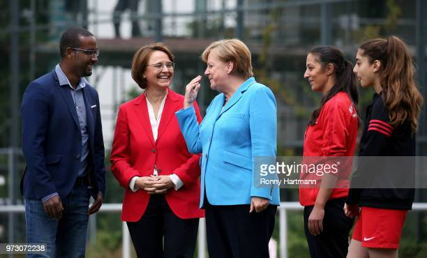 German Chancellor Angela Merkel chats with former German National player Cacau Federal Commissioner for Migration Refugees and Integration Annette...