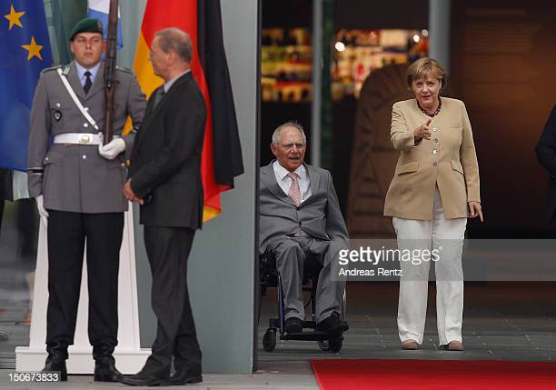 German Chancellor Angela Merkel chats with German Finance Minister Wolfgang Schaeuble prior to Greek's Prime Minister Antonis Samaras arrival at the...