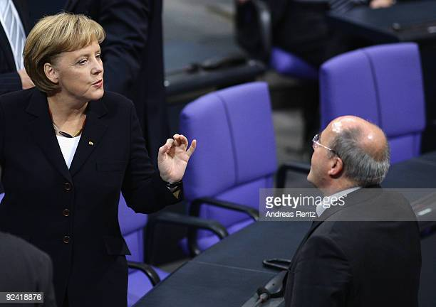 German Chancellor Angela Merkel chats with Gregor Gysi Chairman of the German leftwing party Die Linke faction at the Bundestag on October 28 2009 in...