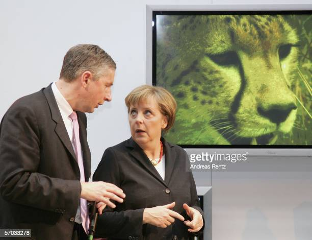 German Chancellor Angela Merkel chats with Klaus Kleinfeld , CEO of Siemens at CeBIT on March 9, 2006 in Hanover, Germany. The world's largest...