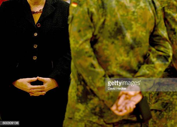 German Chancellor Angela Merkel chats with members of the 'Ostfriesland' rapidreaction medical unit of the Bundeswehr the German armed forces during...