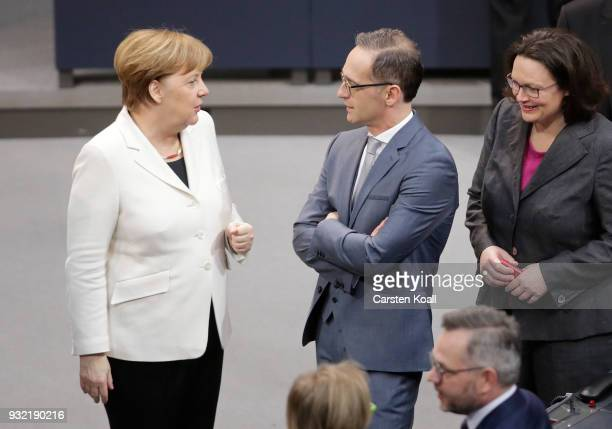 German Chancellor Angela Merkel chats with new German Foreign Minister Heiko Maas following Merkel's election by the Bundestag for a fourth term as...