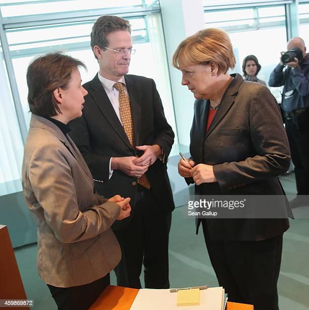 German Chancellor Angela Merkel chats with Nikolaus MeyerLandrut chief adviser to the cabinet for European affairs and Beate Baumann Merkel's closest...