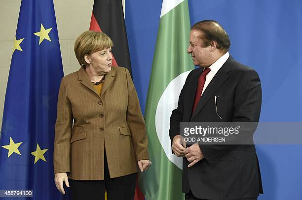 German Chancellor Angela Merkel chats with Pakistani Prime Minister Nawaz Sharif after their joint press conference following their meeting at the...