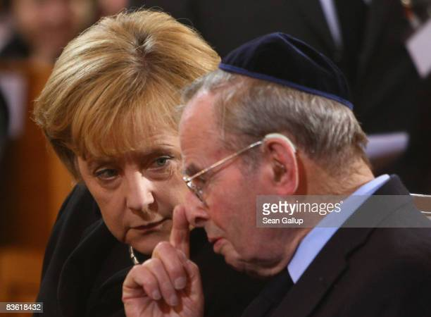 German Chancellor Angela Merkel chats with publisher and Kristallnacht eyewitness Ernst Cramer at a commemorative service for the 70th anniversary of...