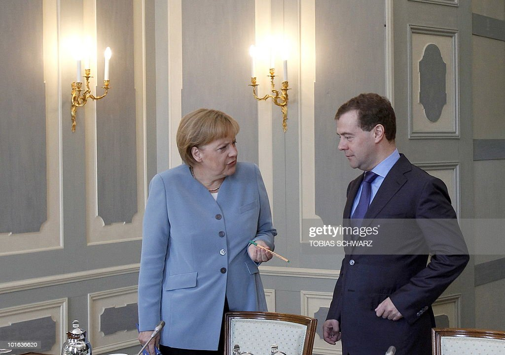 German Chancellor Angela Merkel chats with Russian President Dmitry Medvedev before bilateral talks at the government guest house Schloss Meseberg, some 70 kilometres (43.5 miles) north of Berlin, June 5, 2010. Medvedev is in Germany for two days of what the German government called 'informal' discussions set to be dominated by Iran's nuclear programme and the Middle East.