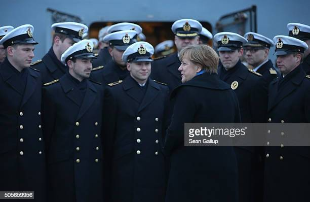 German Chancellor Angela Merkel chats with sailors of the German Navy while she visited the 'Braunschweig' warship on January 19 2016 in Kiel Germany...