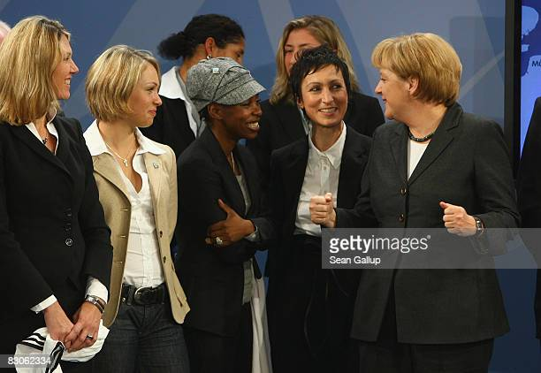 German Chancellor Angela Merkel chats with socalled ambassadors for the 2001 Women's World Football Championships including Beatrice Weder di Mauro...