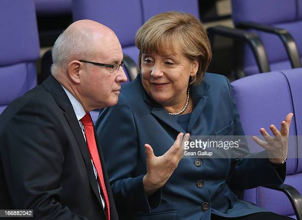 German Chancellor Angela Merkel chats with Volker Kauder Chairman of the CDU/CSU parliamentary group in the Bundestag prior to debates over EU...