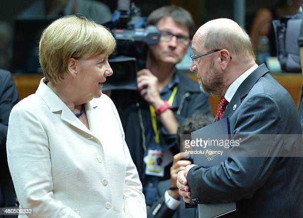 German Chancellor Angela Merkel confers with European Parliament President Martin Schulz ahead of the eurozone leaders' summit on the Greek crisis at...