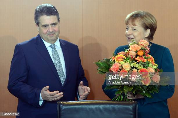 German Chancellor Angela Merkel congratulates Economy Minister and Vice Chancellor Sigmar Gabriel to the birth of a daughter prior to the weekly...