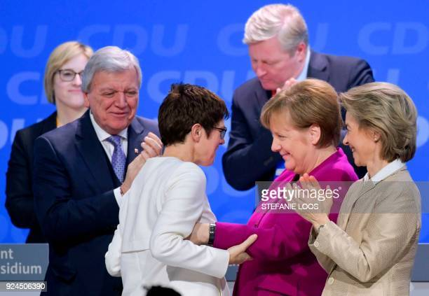 German Chancellor Angela Merkel congratulates Saarland's State Premier Annegret KrampKarrenbauer who was elected secretary general of the Christian...