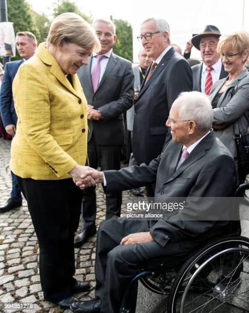 German chancellor Angela Merkel congratulates the German finance minister Wolfgang Schäuble on his 75th birthday in the Reithalle in the Culture...