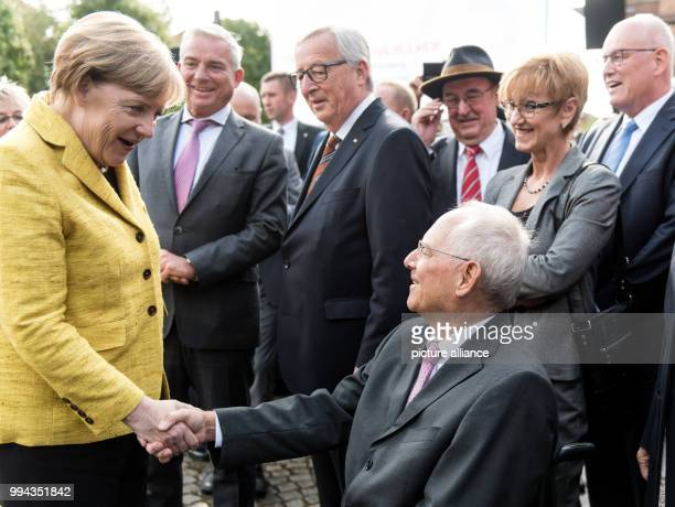 German chancellor Angela Merkel congratulates the German finance minister Wolfgang Schaeuble on his 75th birthday in the Reithalle in the Culture...