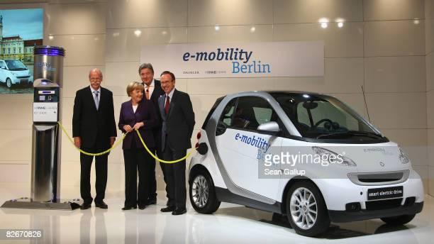 German Chancellor Angela Merkel Daimler head Juergen Zetsche Juergen Grossmann CEO of German power supplier RWE and Matthias Wissmann Chairman of the...