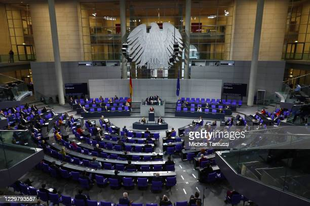 German Chancellor Angela Merkel delivers a government address at the Bundestag on the German government's updated policies to fight the coronavirus...