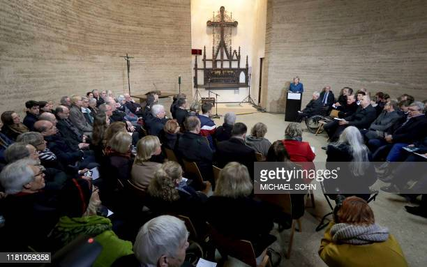 German Chancellor Angela Merkel delivers a speech during a memorial service inside the Chapel of Reconciliation during the central commemoration...