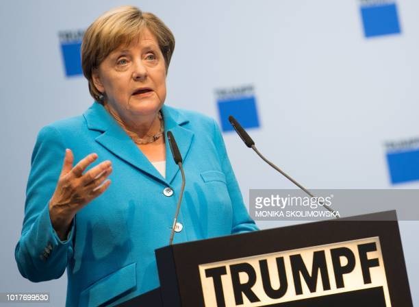 German Chancellor Angela Merkel delivers a speech during a visit of the Trumpf Sachsen GmbH engineering company in Neukirch near Dresden eastern...