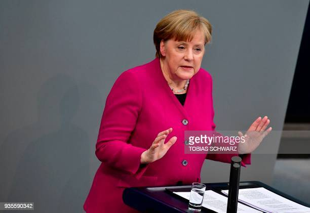 German Chancellor Angela Merkel delivers a speech to parliament on March 21 2018 at the Bundestag in Berlin Merkel outlined her government's plans a...