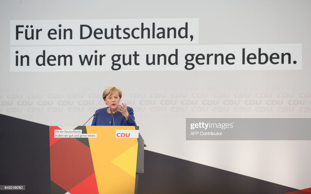 German Chancellor Angela Merkel delivers her speech as she attends an electoral meeting in Delbrueck, western Germany, on September 10, 2017. / AFP PHOTO / dpa / Friso Gentsch / Germany OUT