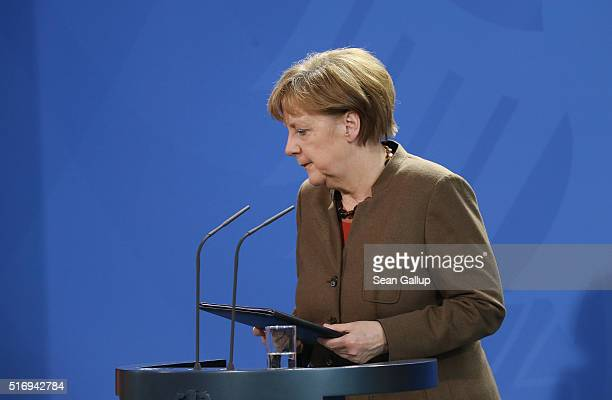 German Chancellor Angela Merkel departs after giving a statement to the media following today's terrorist attacks in Brussels on March 22 2016 in...