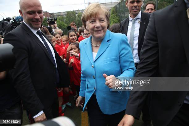 German Chancellor Angela Merkel departs at the conclusion of her visit to a program to encourage integration of children with foreign roots through...