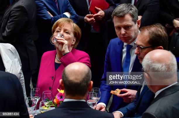 German Chancellor Angela Merkel drinks up as CSU politician Thomas Silberhorn and parliamentary group leader of the Bavarian Christian Social Union...