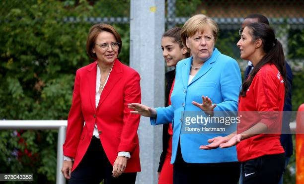 German Chancellor Angela Merkel during her visit of a program to encourage integration of children with foreign roots through football as Federal...