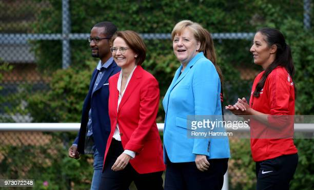 German Chancellor Angela Merkel during her visit of a program to encourage integration of children with foreign roots through football as former...