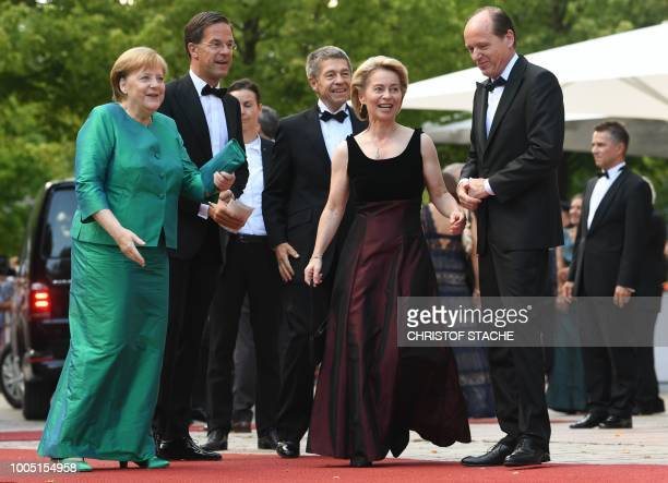 German Chancellor Angela Merkel Dutch Prime Minister Mark Rutte Merkel's husband Joachim Sauer German Defence Minister Ursula von der Leyen and her...